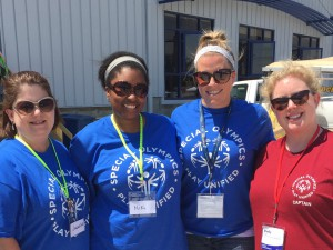 Indy Podiatry staff members Jacqueline, Niki, Dr. Higgins and Dr. Bowers working the Fit Feet tent at the Indiana Special Olympics games