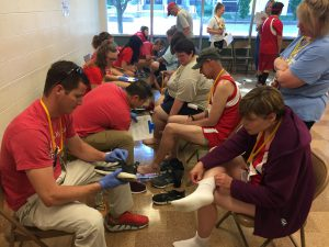 Athletes receive podiatry screenings before the games